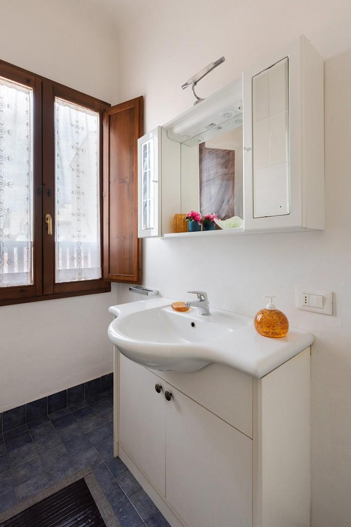 Bathroom gets good light. It has a fully enclosed shower, sink, toilet and bidet.