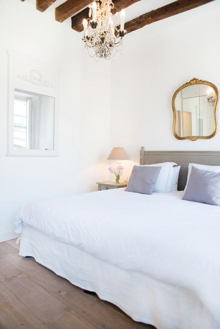 The bedroom is a tranquil retreat after a long day of exploring the city.