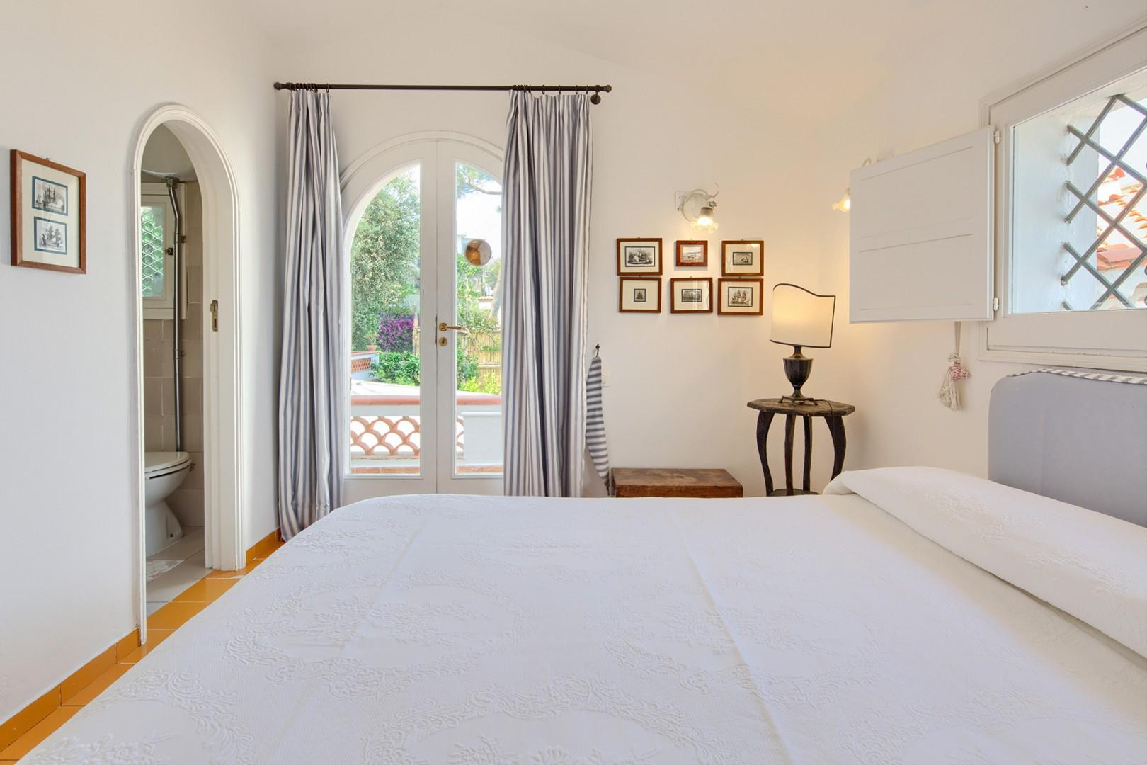 This bedroom has a private terrace access.