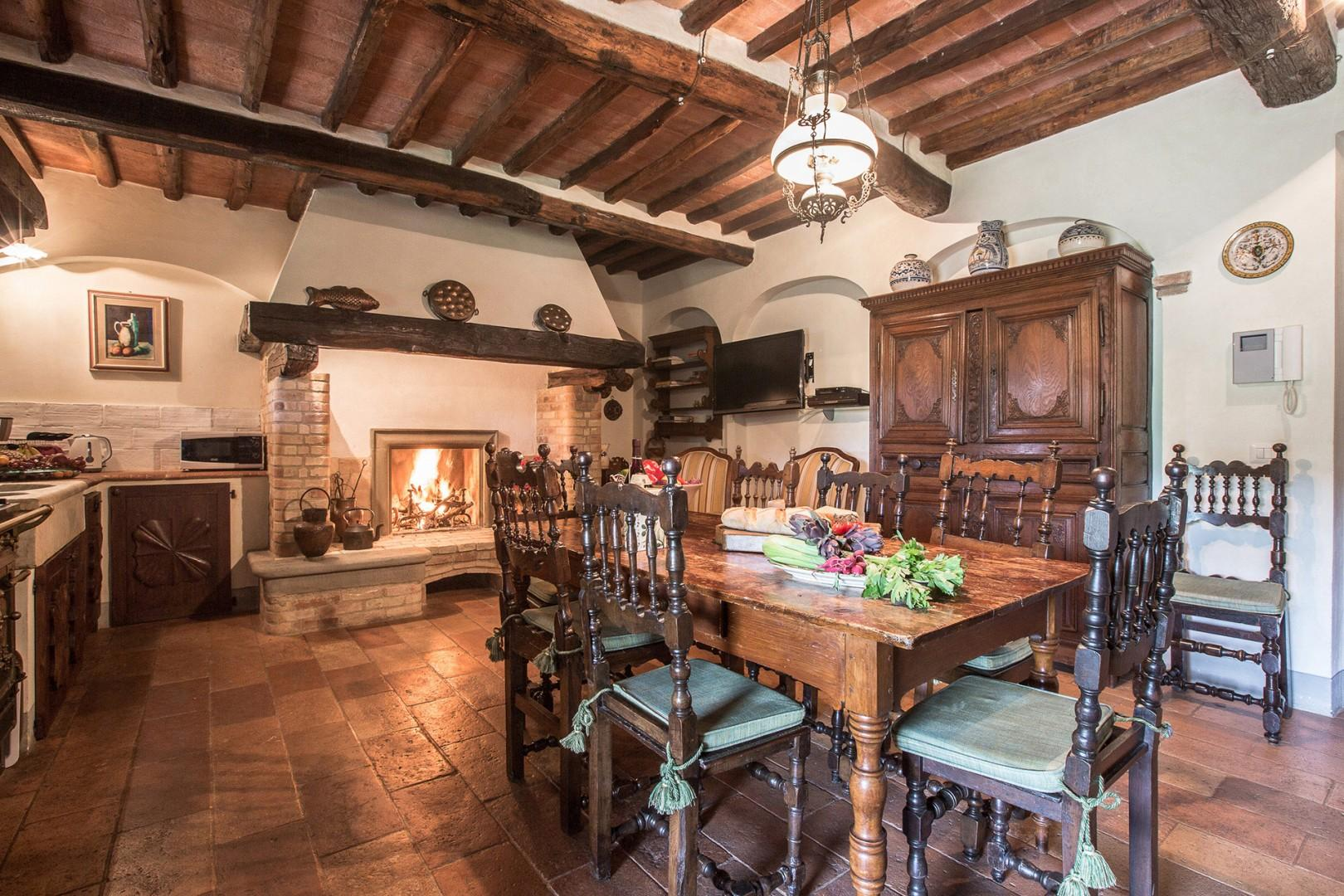The kitchen has a farm table and large working fireplace. Full size refrigerator and freezer.