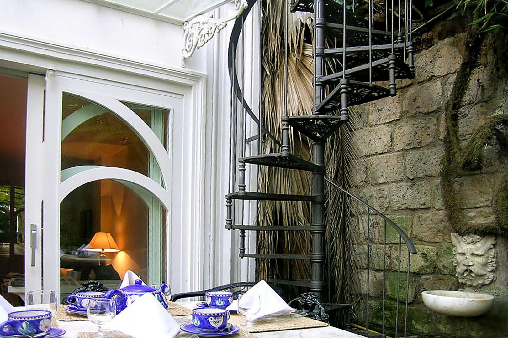 Outside dining area. Spiral stairs leads to the roof.