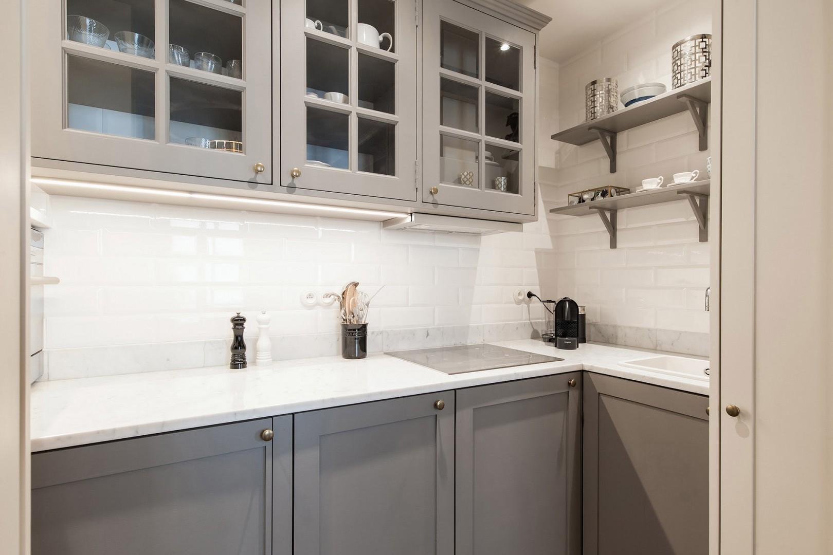 The functional kitchen is ideal for preparing intimate dinners at home.