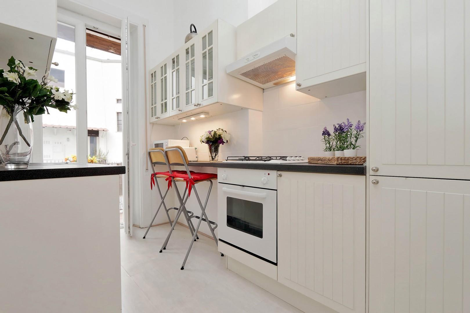 Fully appointed kitchen with a small balcony, good place to put the drying rack for your clothes.