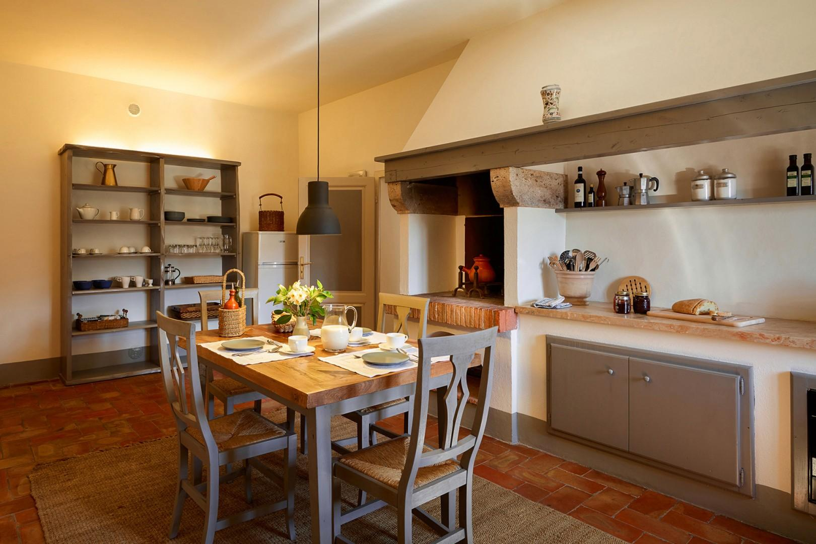 This country kitchen even has an old wood burning oven for character.