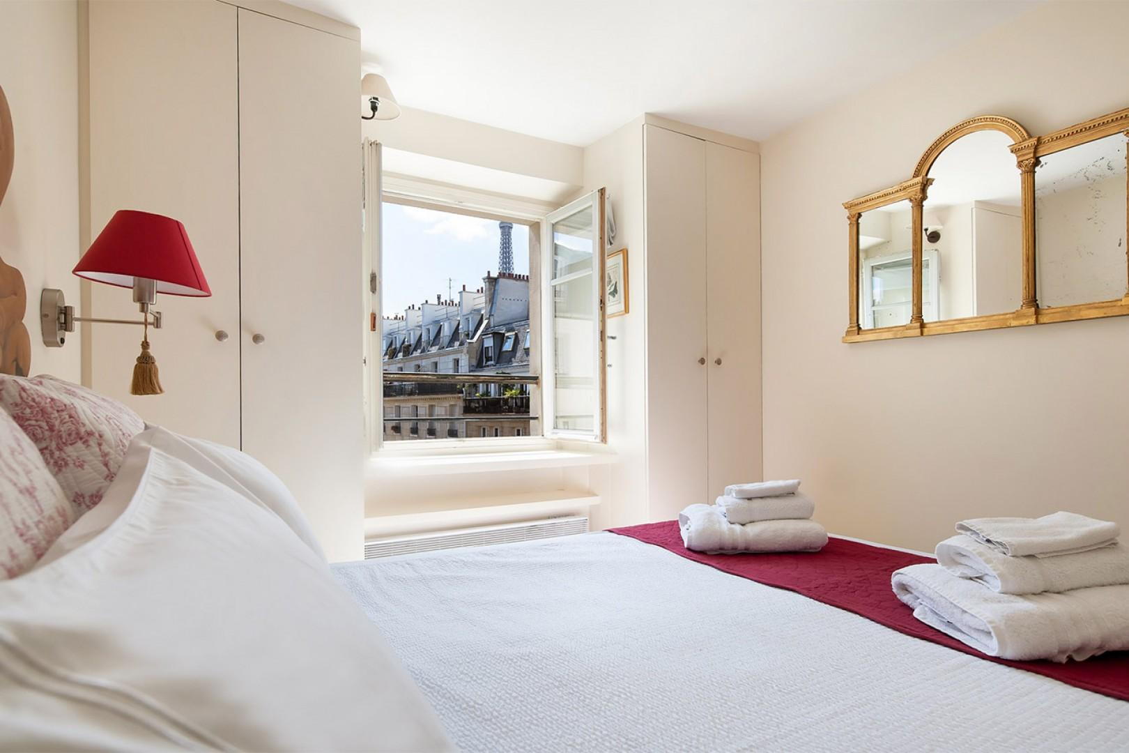 The romantic bedroom has views of the Eiffel Tower!