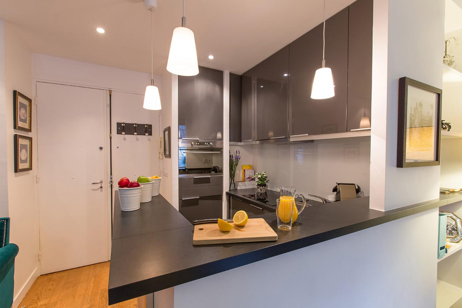 The cleverly designed compact kitchen gives you lots of space to cook.