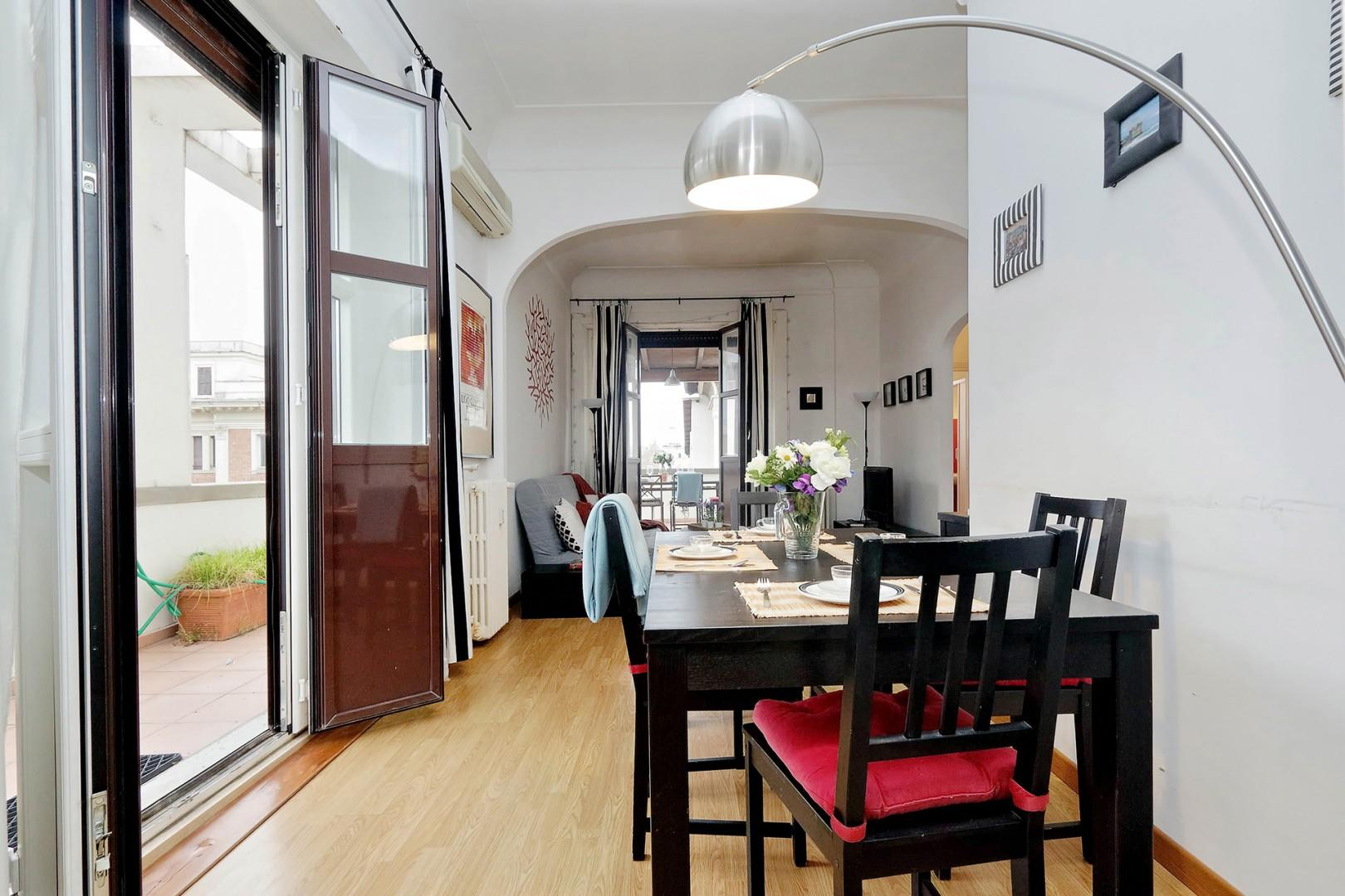 Dining area is illuminated by French doors to the terrace.