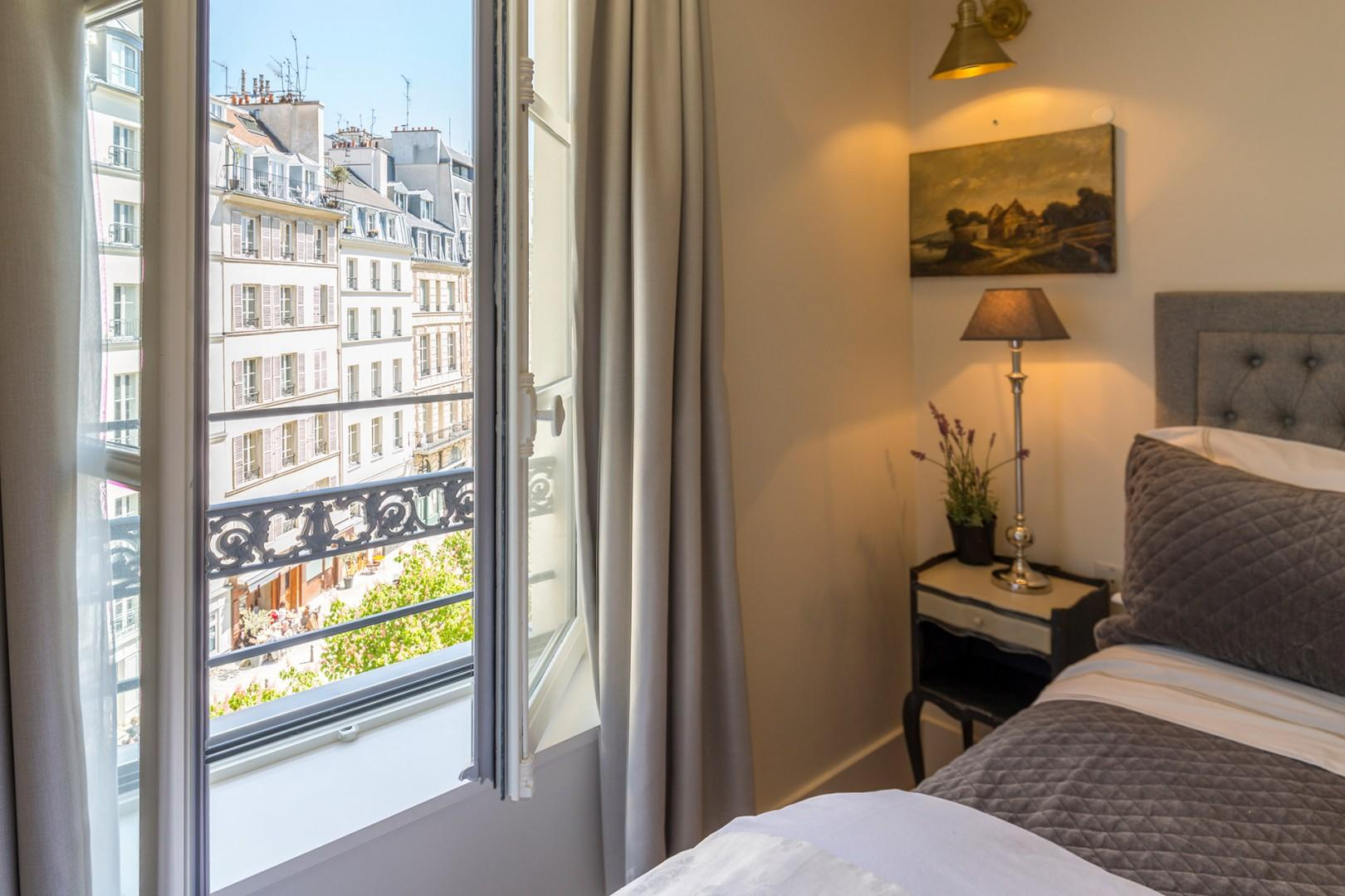 Wake up to the most stunning view over Place Dauphine.