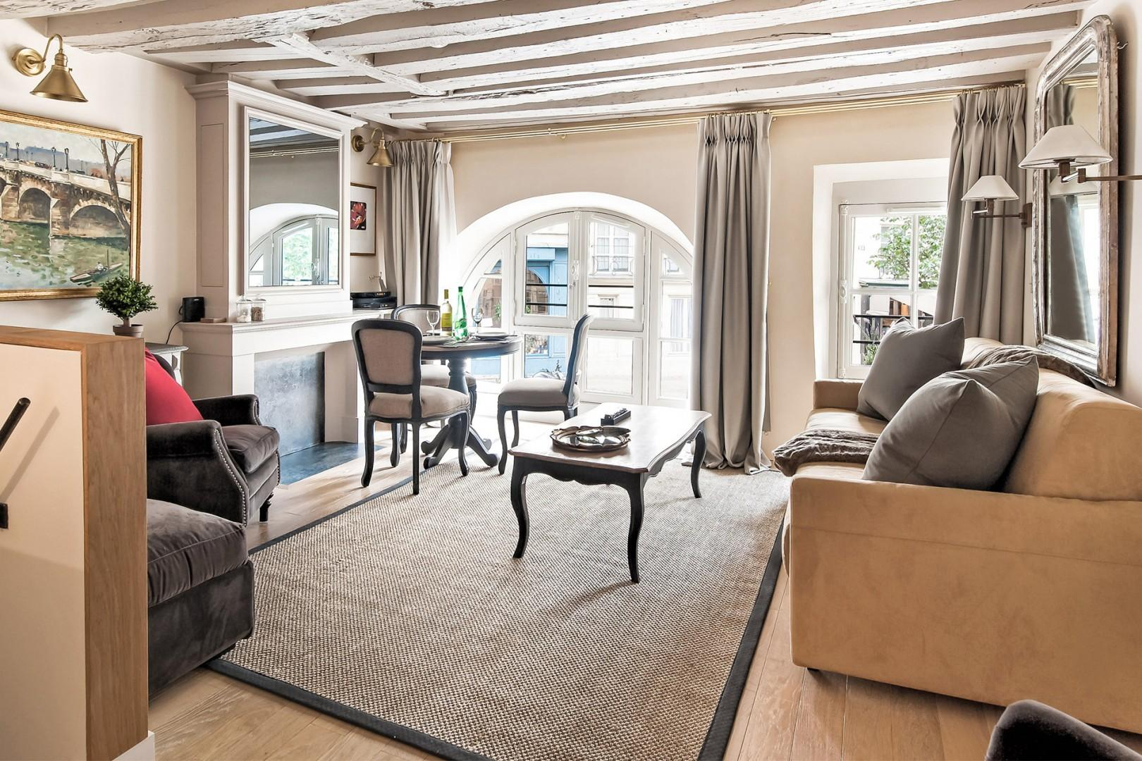 Step into the living room on the second floor, with beautiful wooden beams.