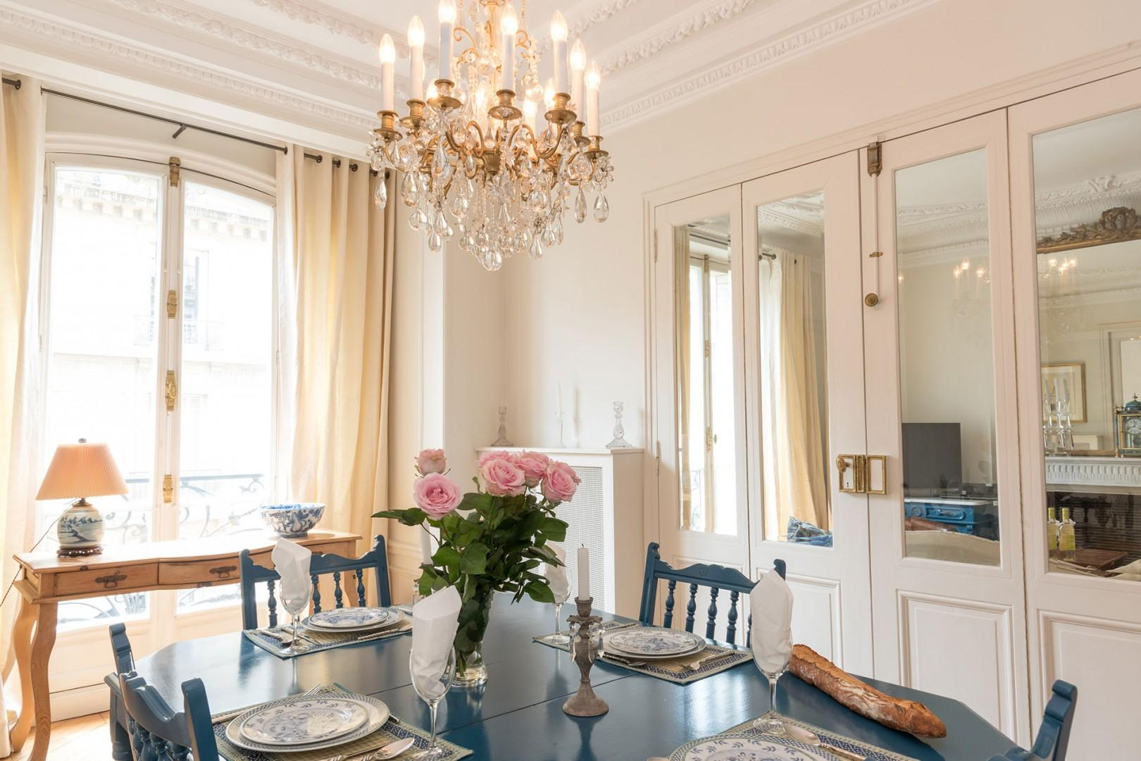 The dining room is separated from the living room with double glass doors.