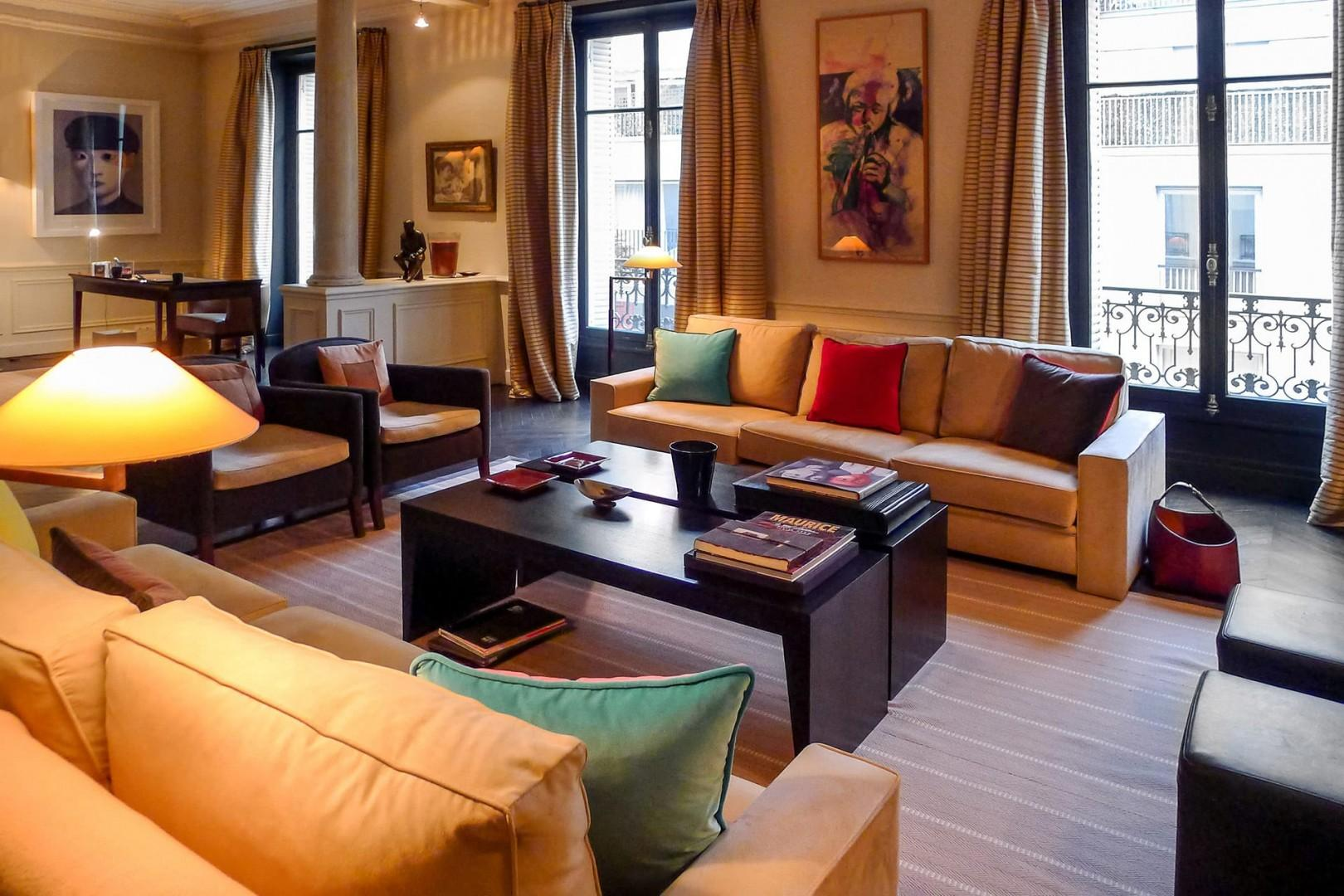 Welcome to the spacious contemporary French living room at the Morgon!