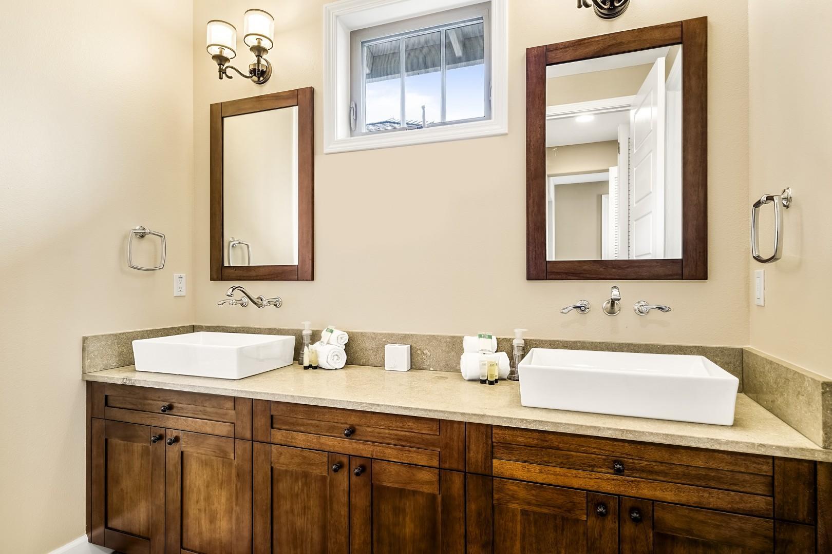 Downstairs guest bathroom with dual vanities