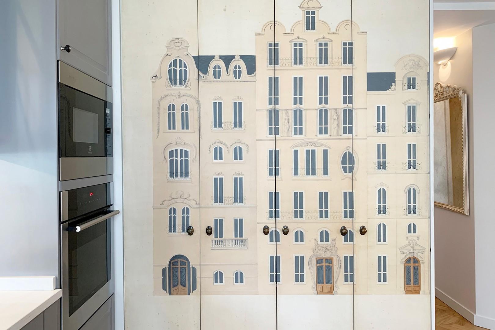 Hand painted Parisian street murals cover the closet doors.