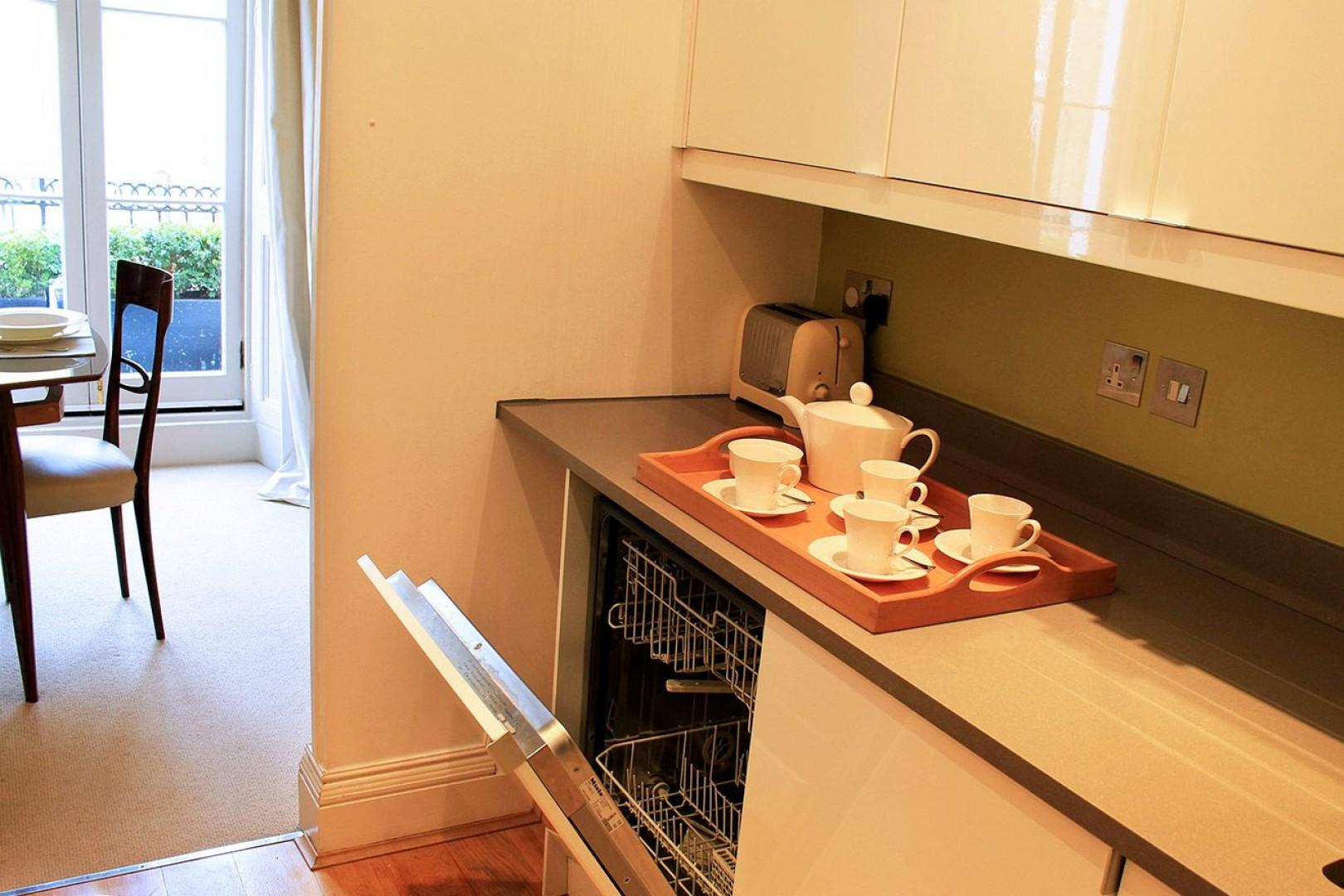 Kitchen is conveniently located just off dining room