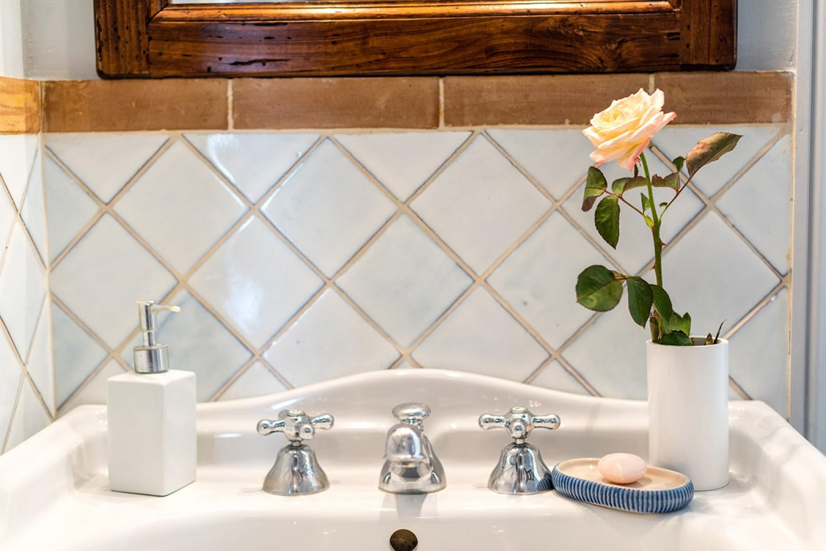 Start your day in this bright and clean bathroom.