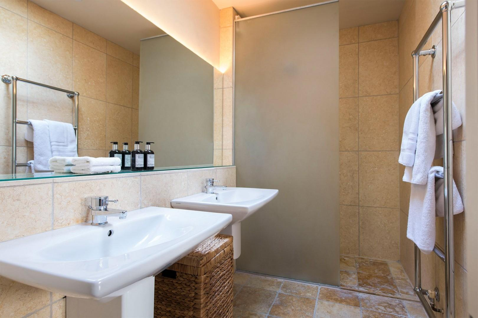 Spacious ensuite bathroom with shower, double sinks and toilet