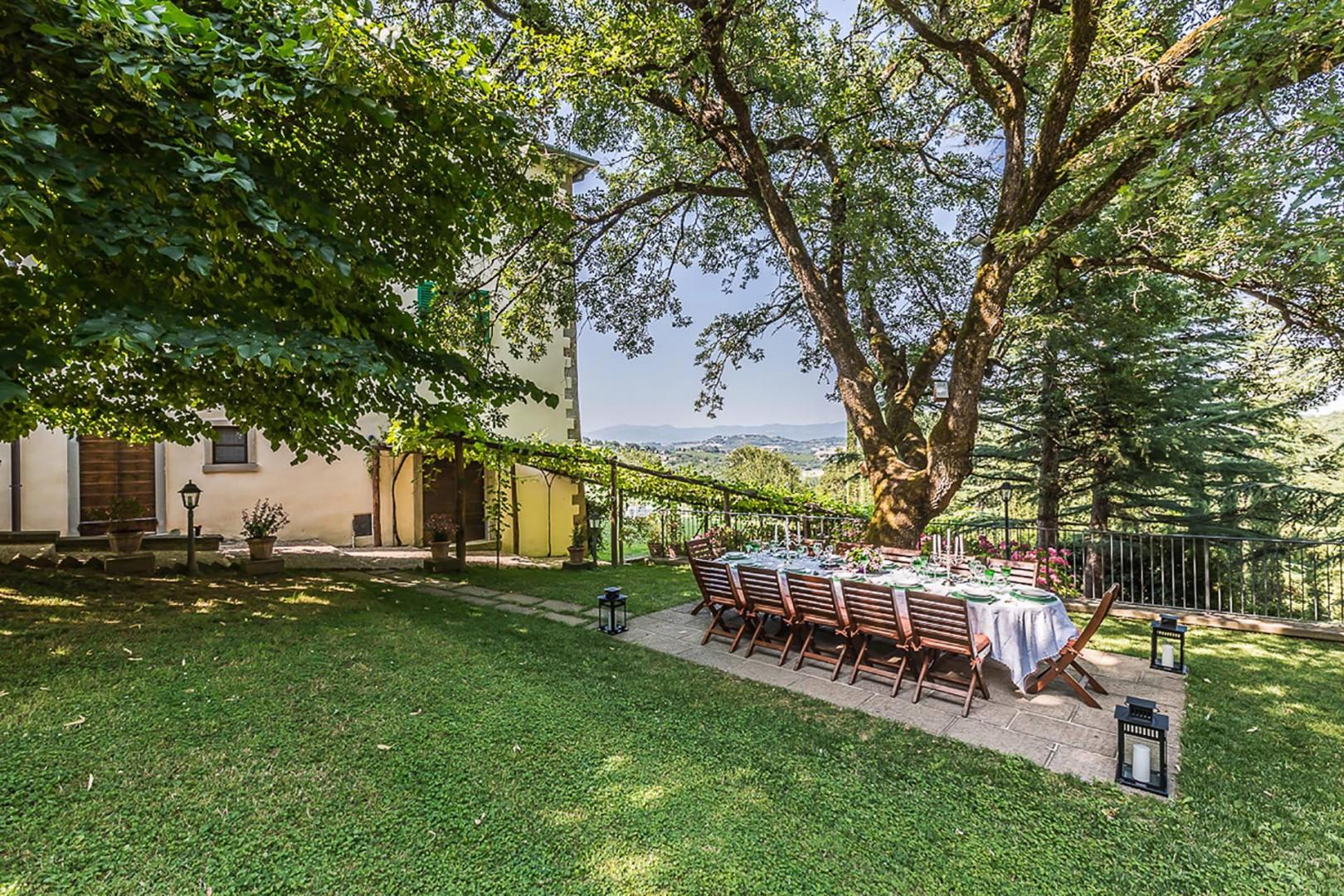 Enjoy the storybook setting of this villa while dining outside.