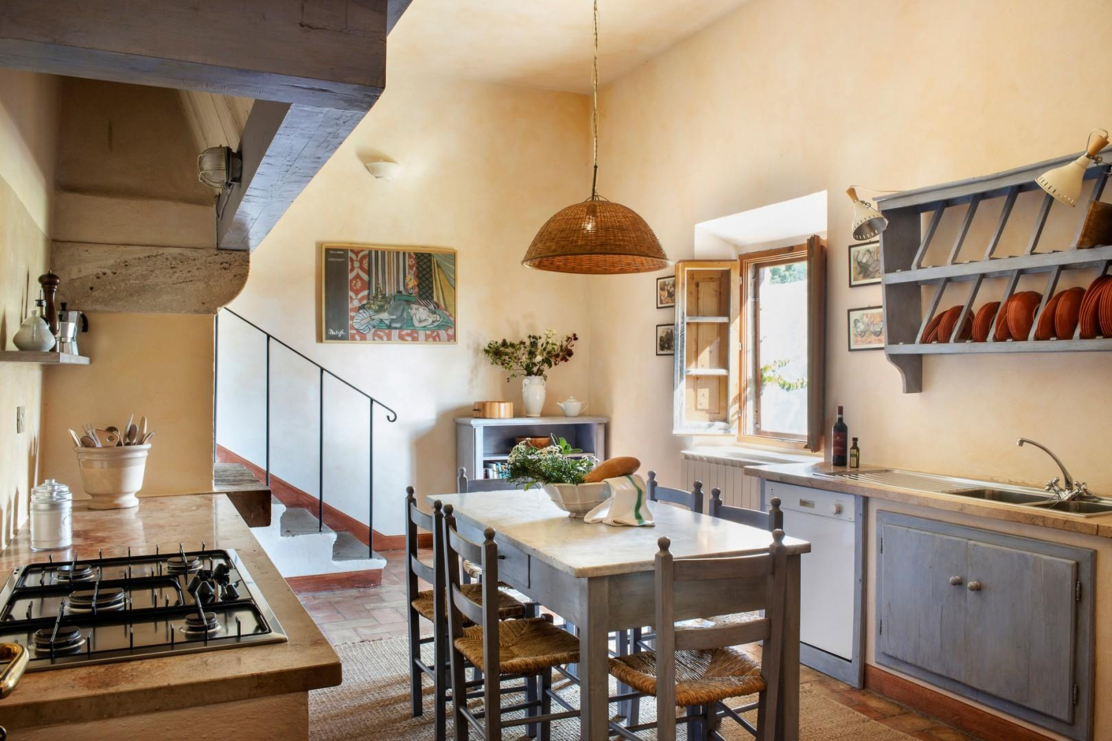 Eat-in country kitchen with a dining table seating 6.