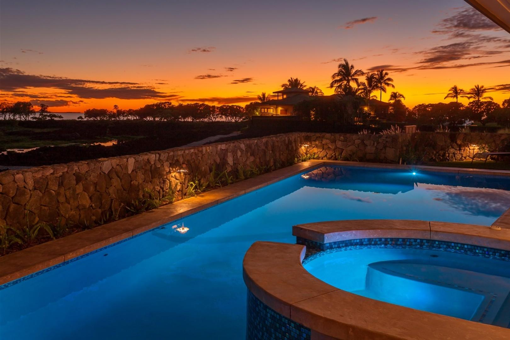 View of this unique two-story open concept luxury home at twilight.