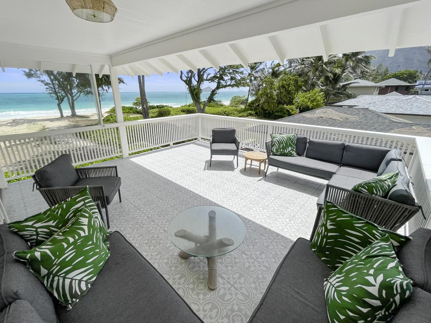 Covered lanai space, is the perfect spot to curl up and watch the sunrise sky light up!