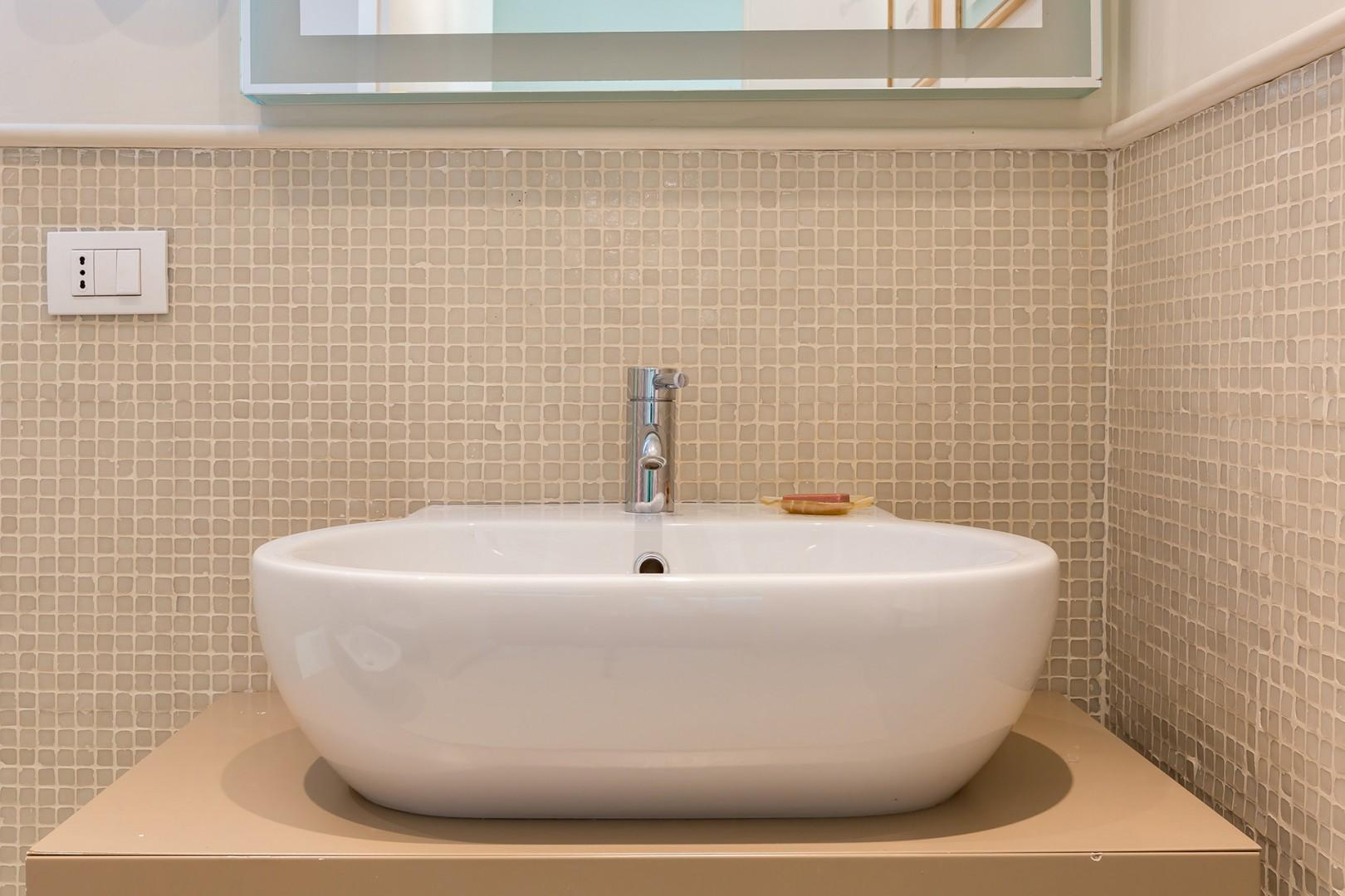 Bathroom with spacious shower and rain style shower head.