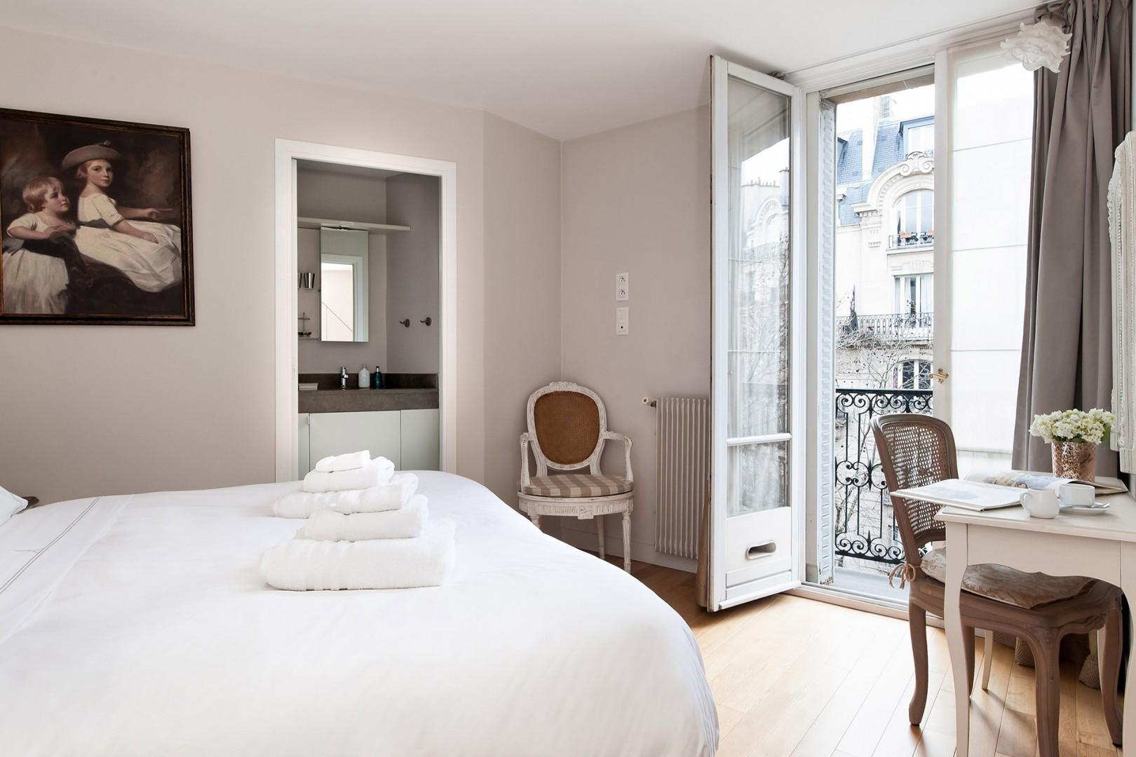 Bedroom 1 has an en suite bathroom, balcony and Eiffel Tower views!