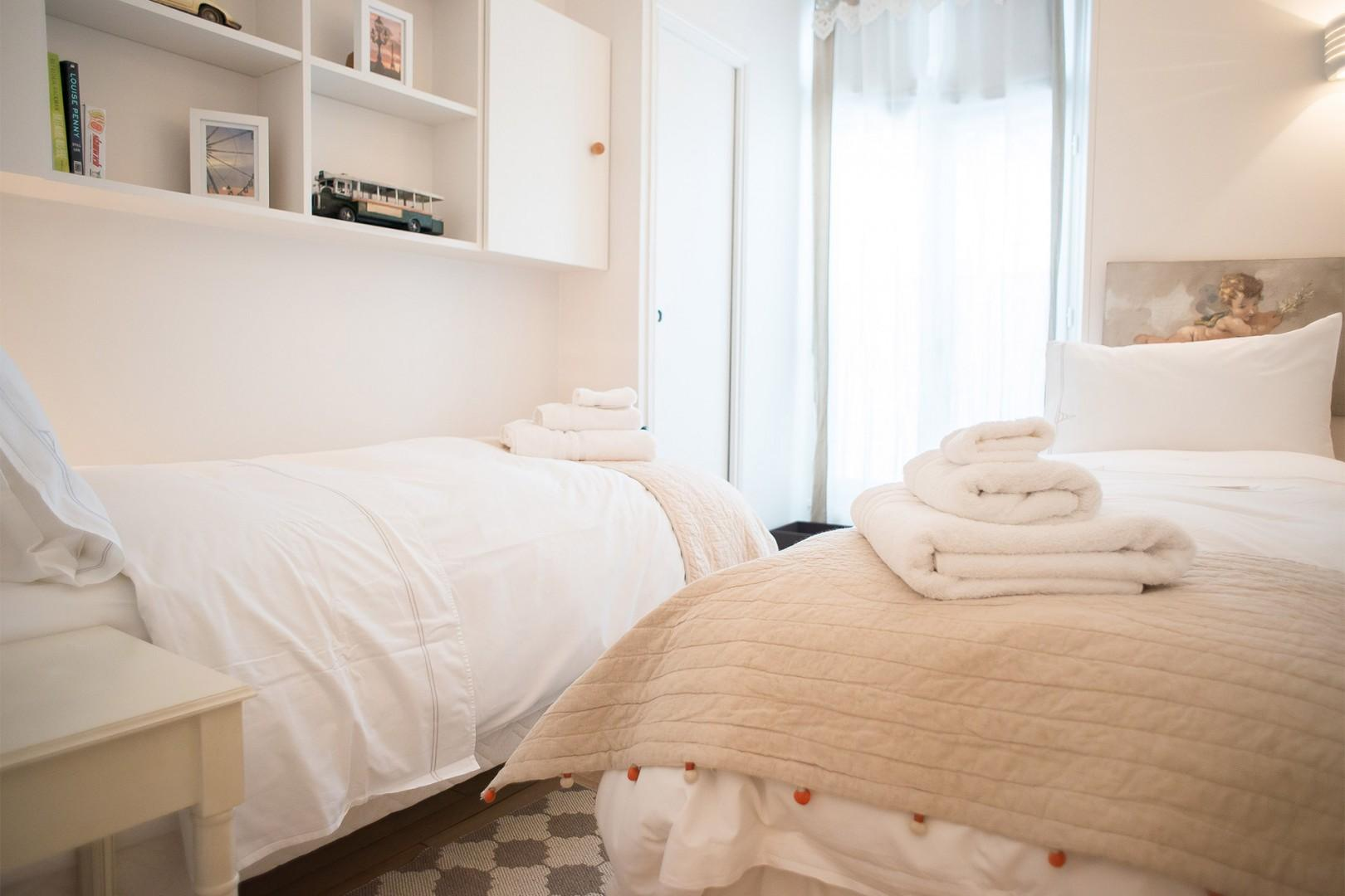 The lovely bedroom 2 has comfortable beds and en suite bathroom.