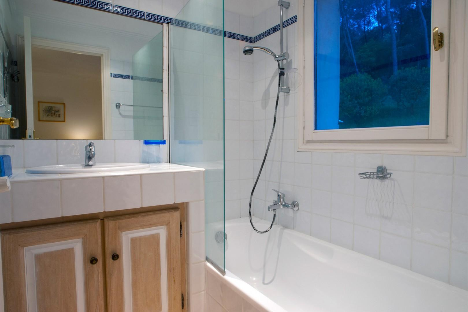 Ensuite bathroom to Bedroom one with a bath with shower fixture and a large sink