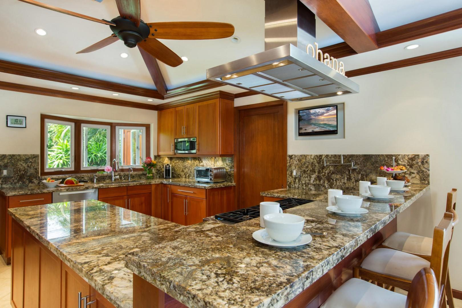 Gourmet kitchen complete with high-end appliances and a dual-fuel six-burner gas oven.