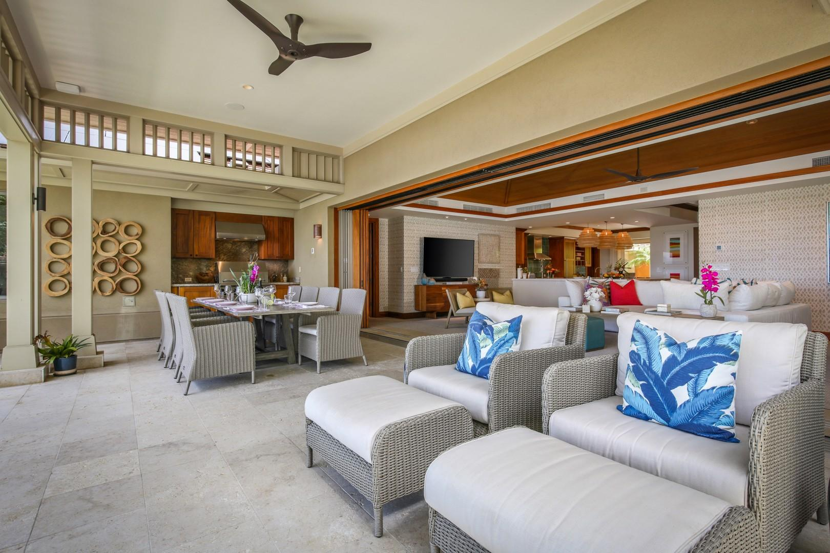 Elegant lounge seating and a gorgeous formal dining table with BBQ grill and prep area.