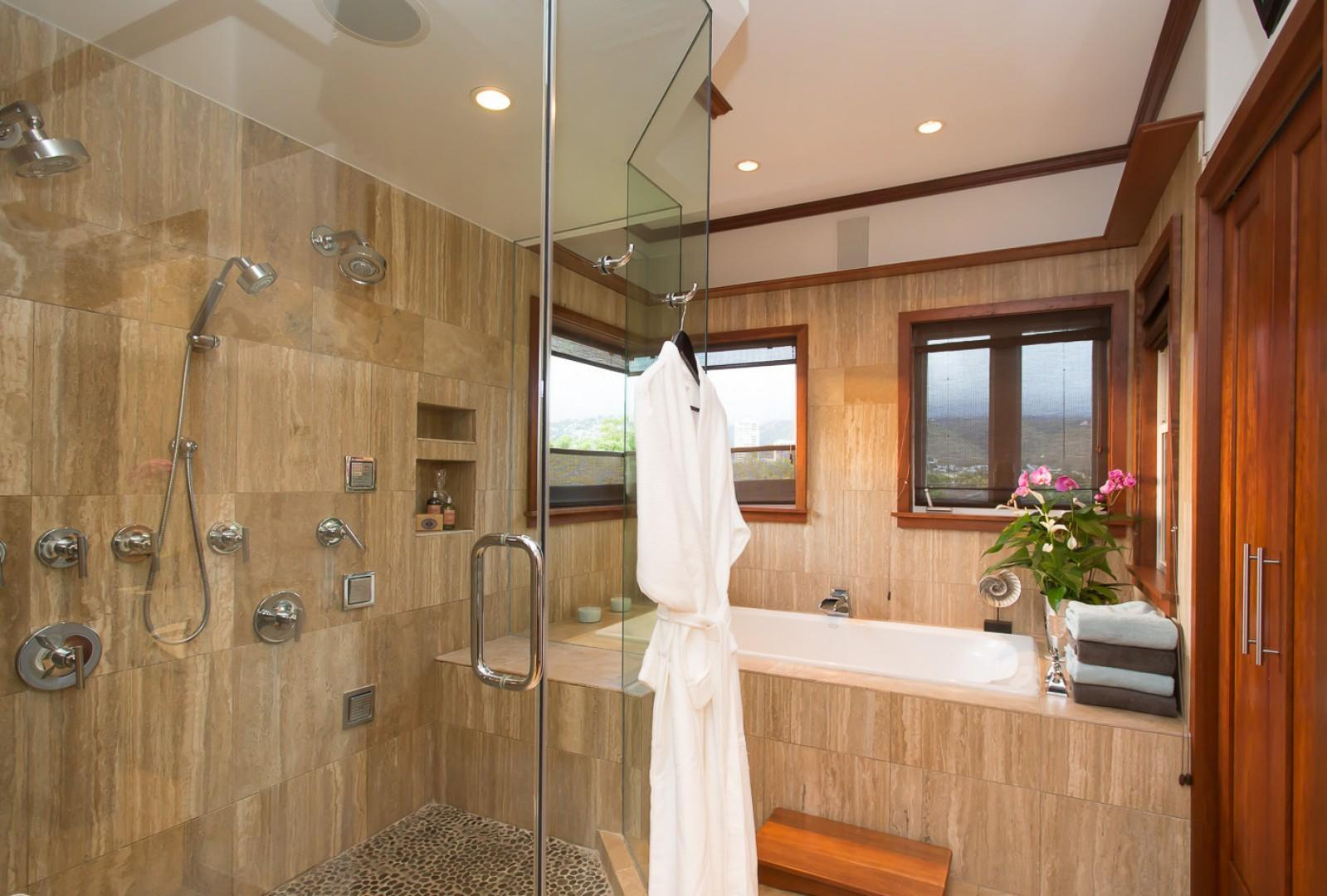 The master bathroom has mountain and city light views from the second floor.