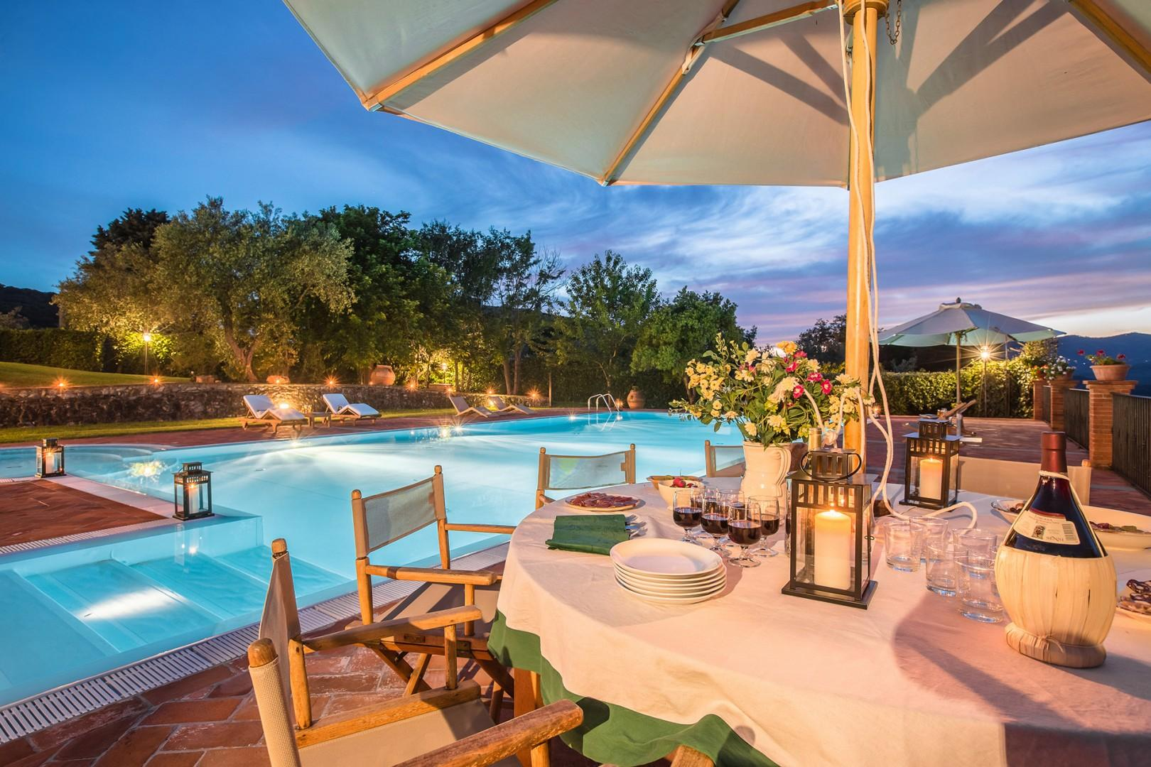 Al fresco dining in this beautiful poolside setting.