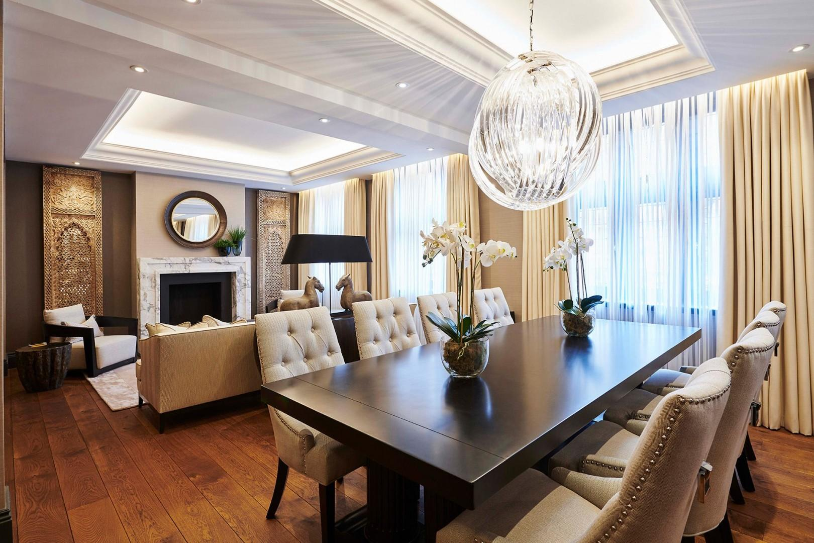 Spacious living area with ornate mantelpiece