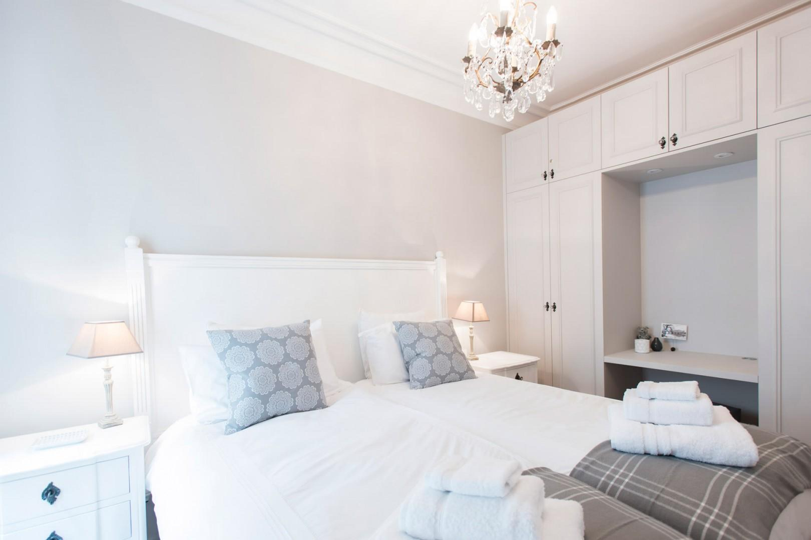 Design elements are soft and welcoming in bedroom 2.