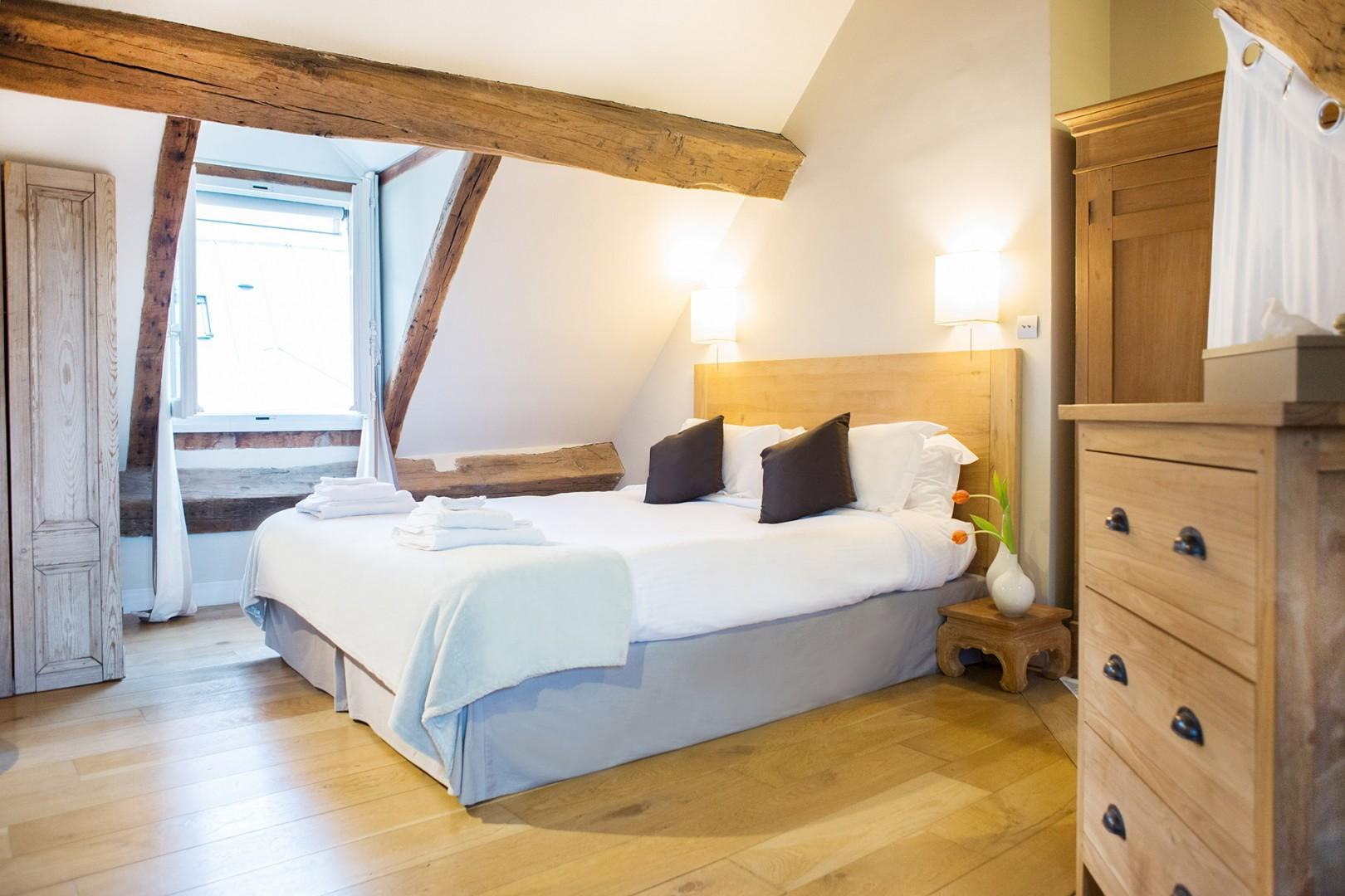 The spacious bedroom 1 has a comfortable bed and an en suite bathroom.
