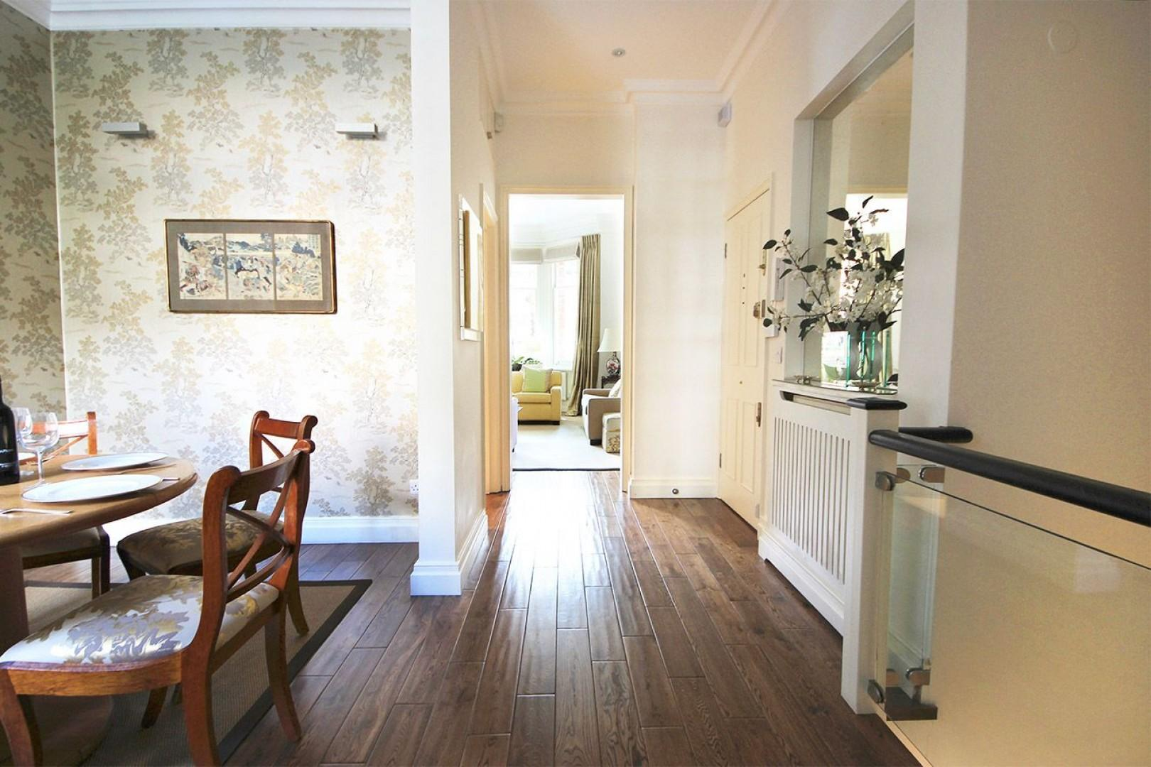 Hallway leads from living room to dining room and kitchen