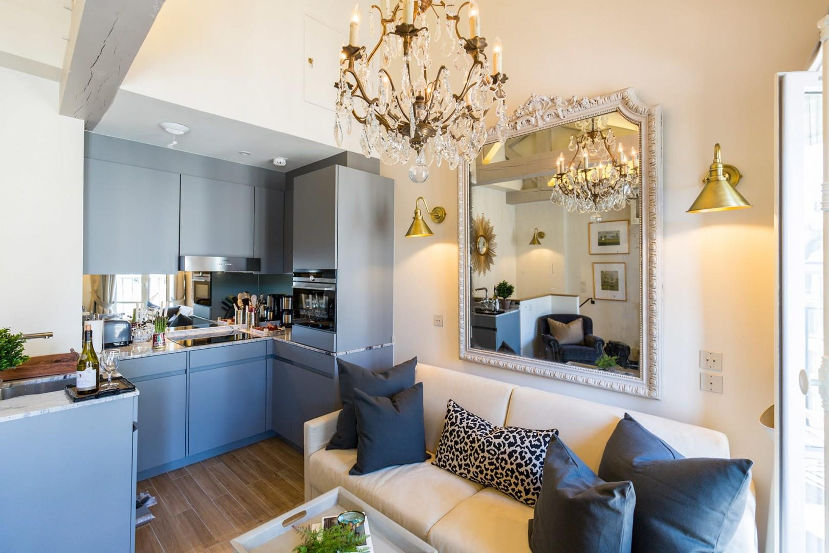 The open-plan living room, dining area and fully equipped kitchen area great for entertaining.