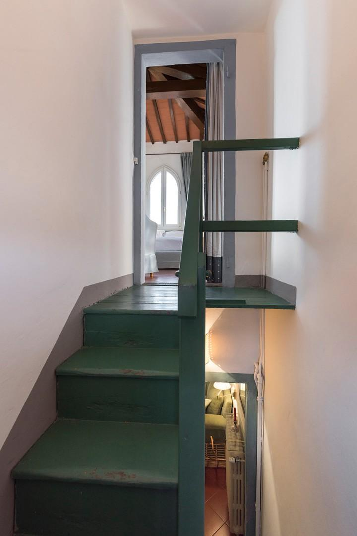 18 steps up to the bedroom. The bathroom is on the living room level.