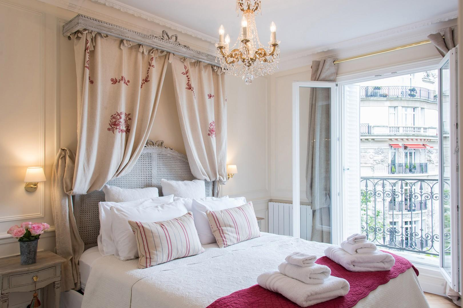 Relax in the romantic bedroom 1 with large French windows.