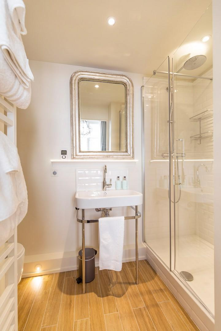 The large shower has a rainfall shower head.
