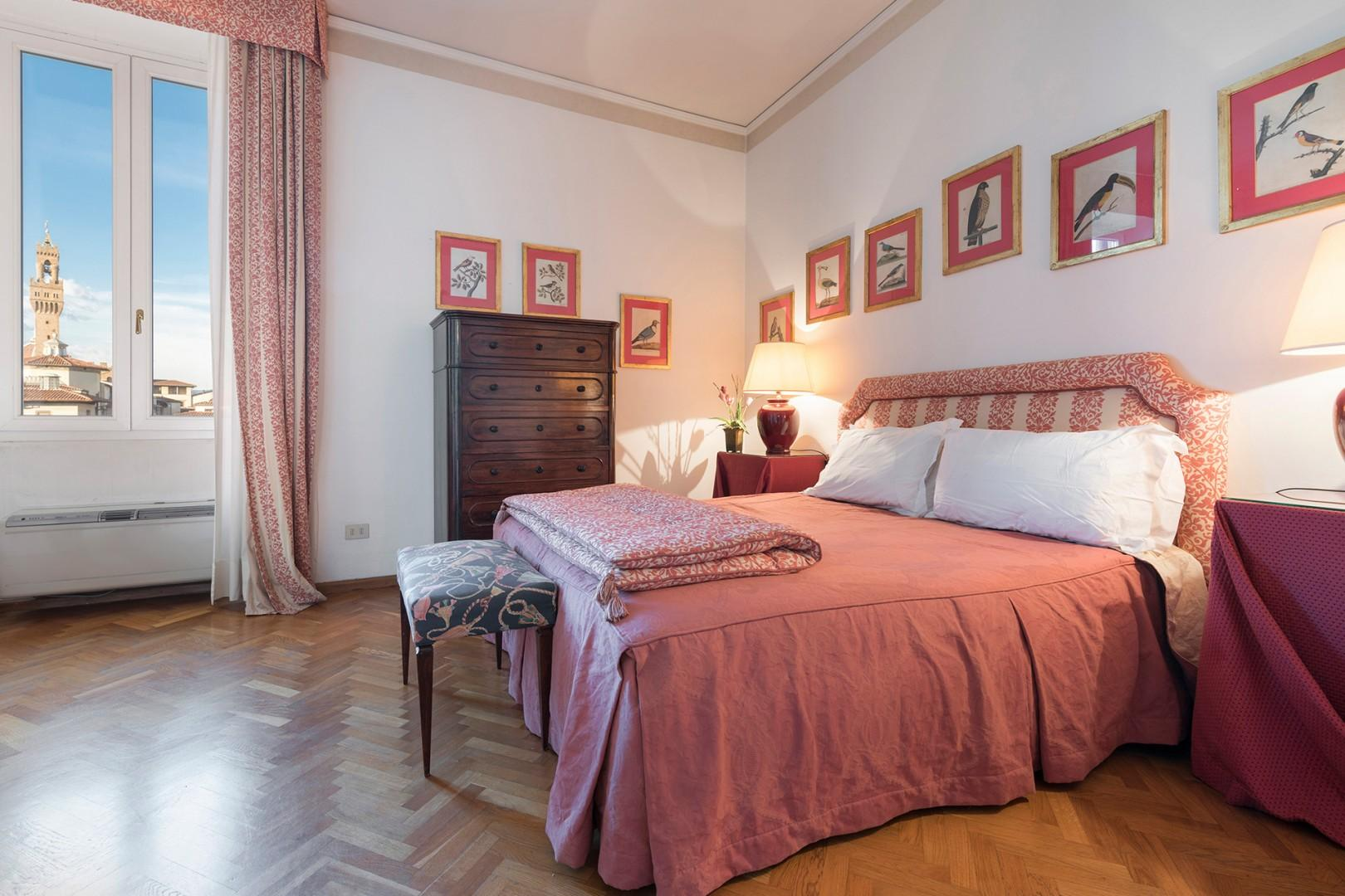 Bedroom 1 has beautiful Arno river views with a bed that can be split to form two beds.