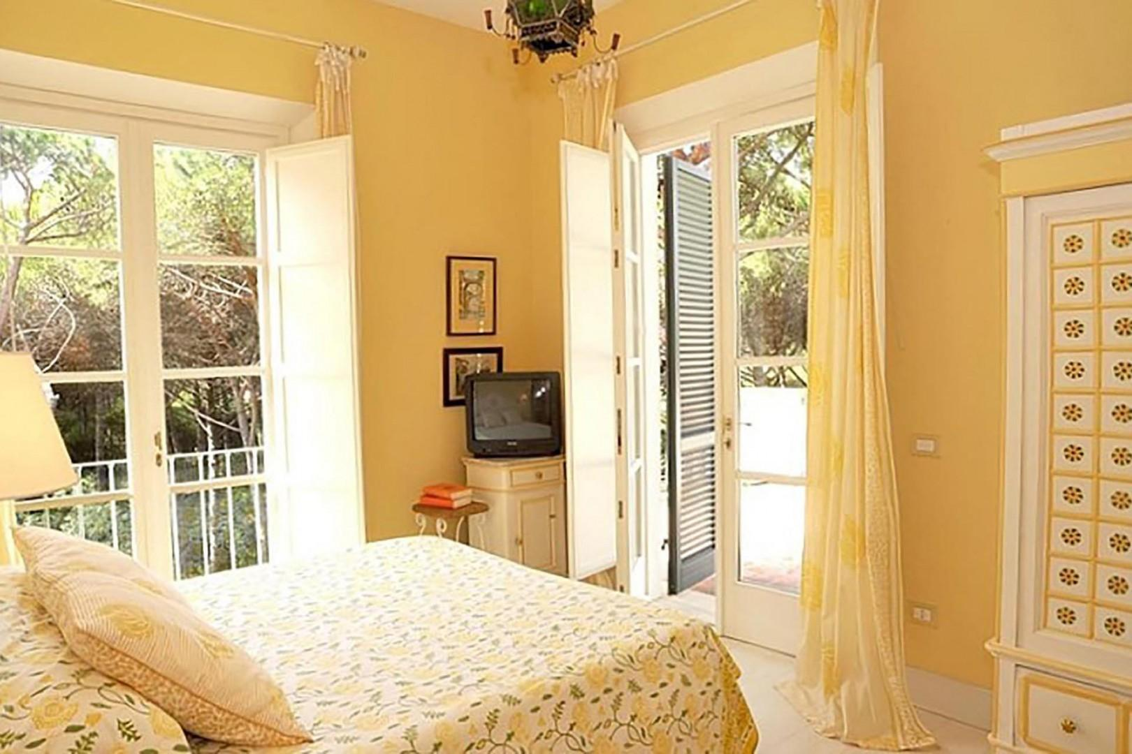 Bedroom 1 with en suite bathroom and balcony access.
