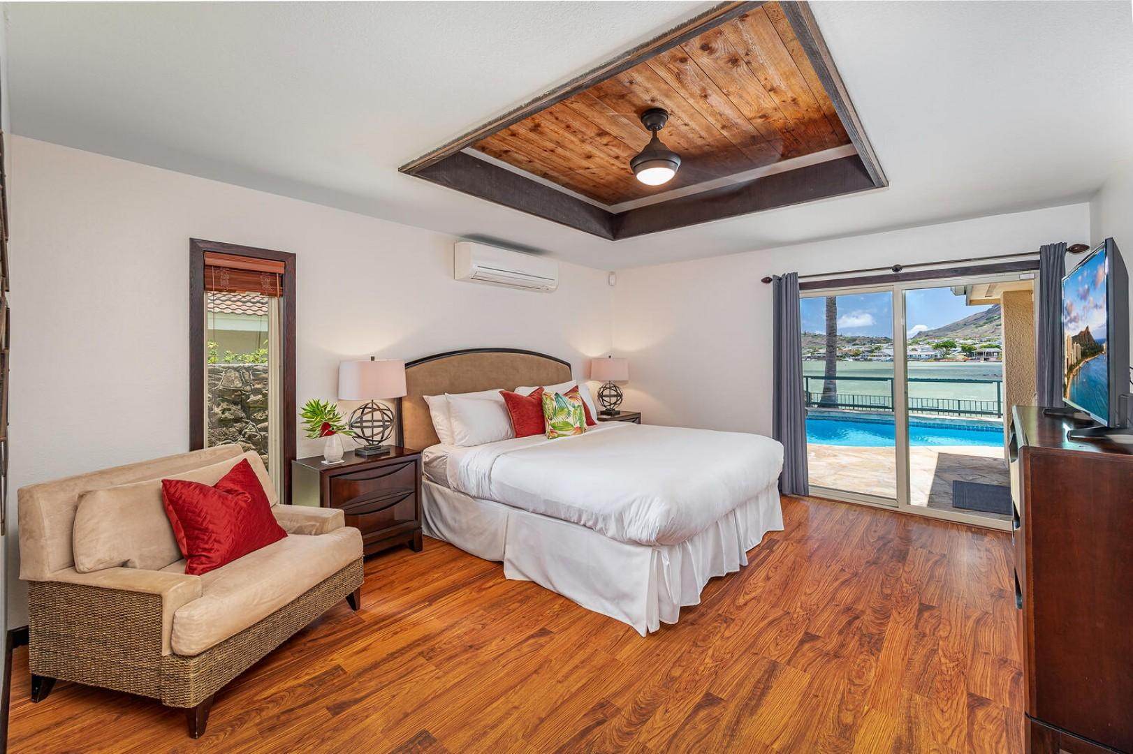 Master bedroom with marina and pool view and its own ensuite and walk in closet.