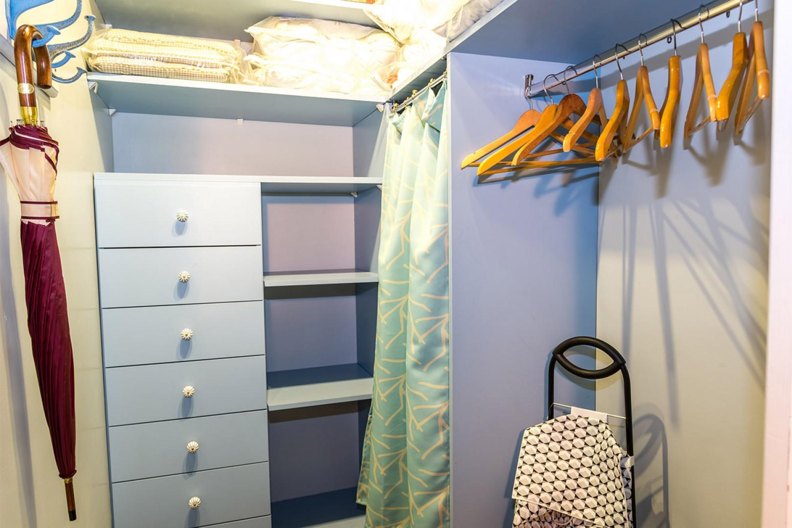 There is a large walk-in closet located off of the hallway.