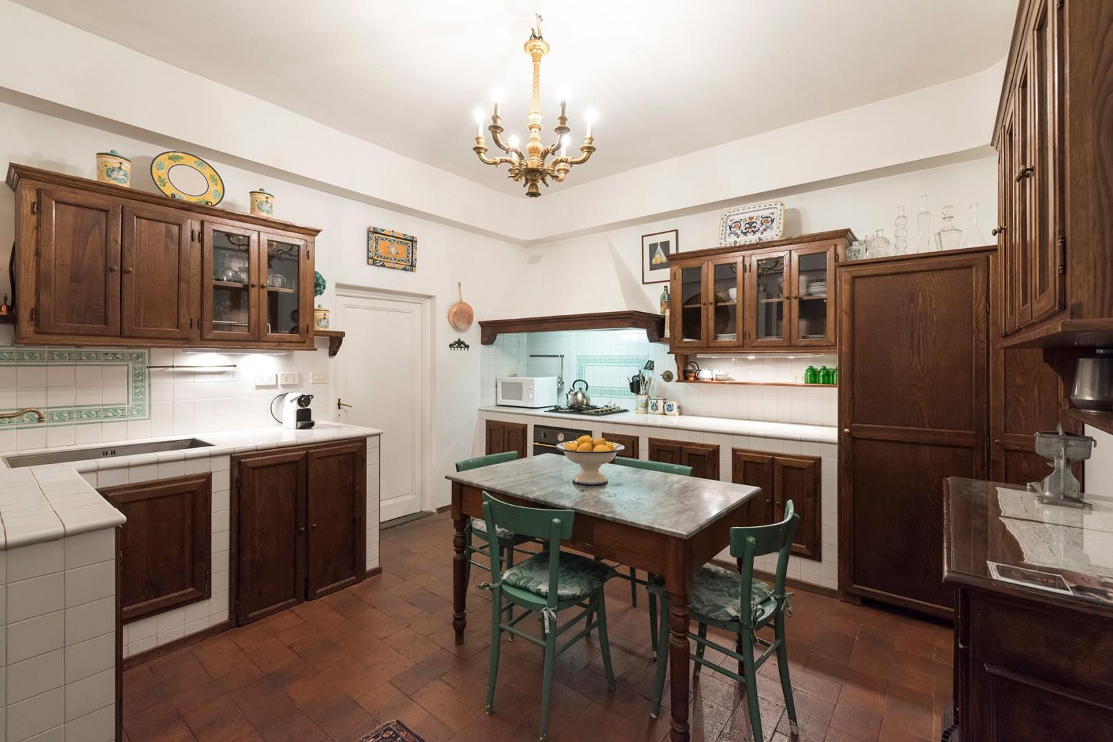 Large eat-in kitchen in the center of the apartment.