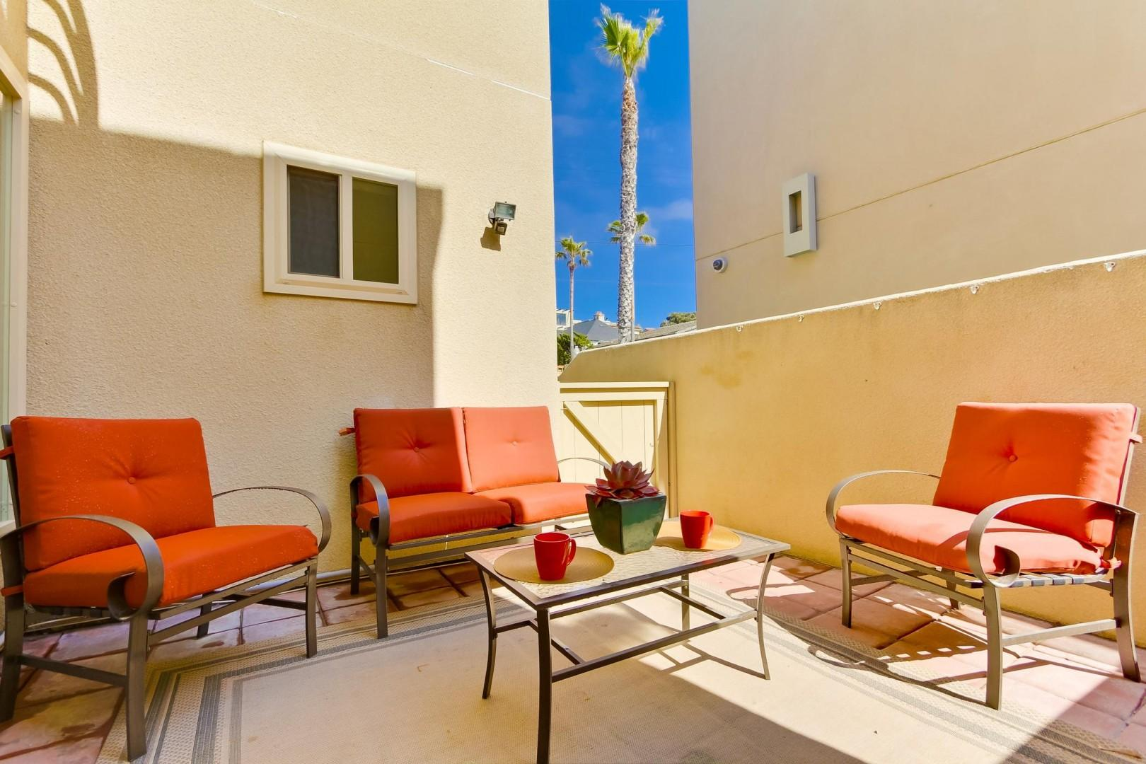 Main level patio with seating and gas BBQ