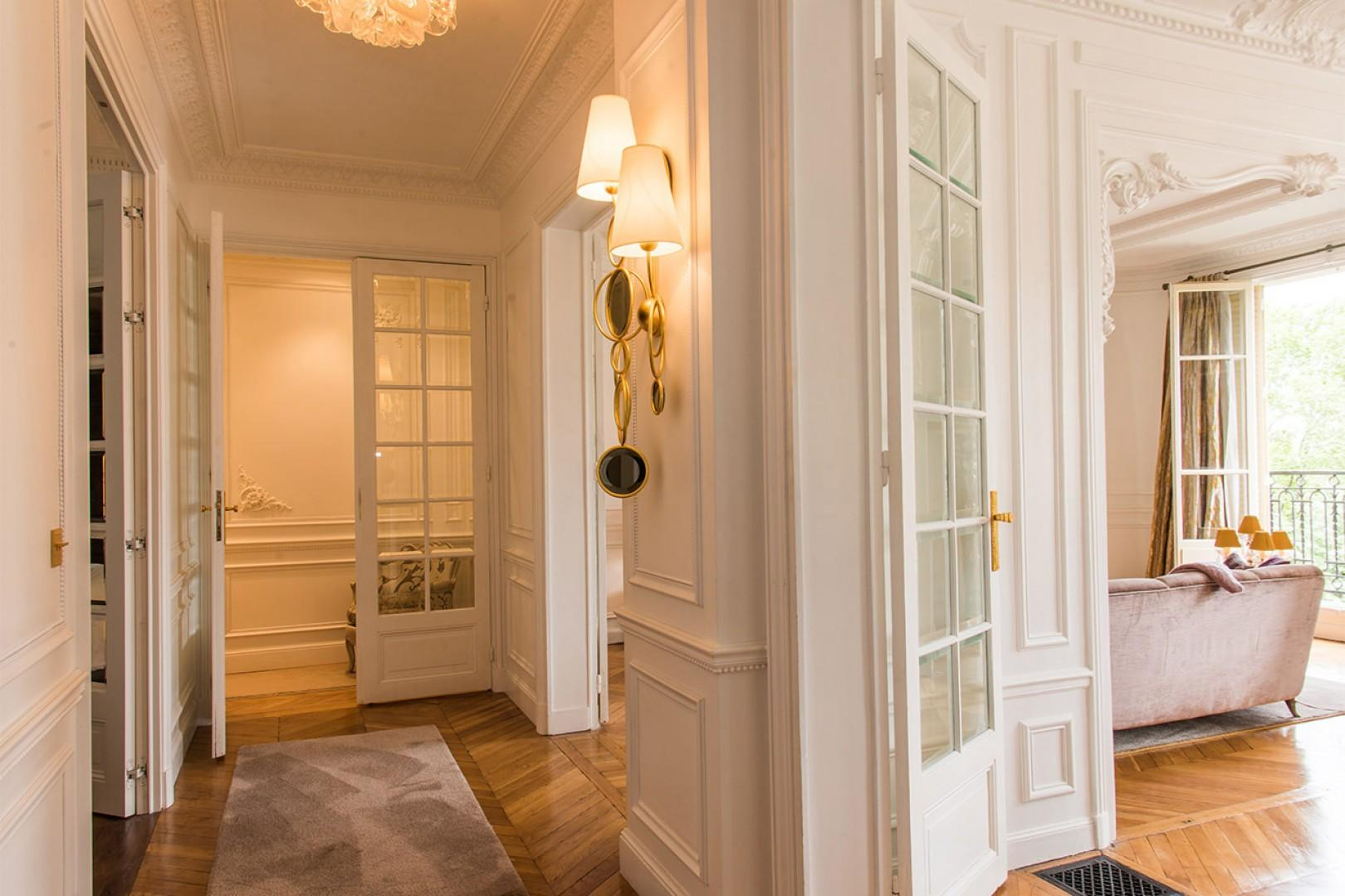 Exquisite French touches continue in the entrance hallway.