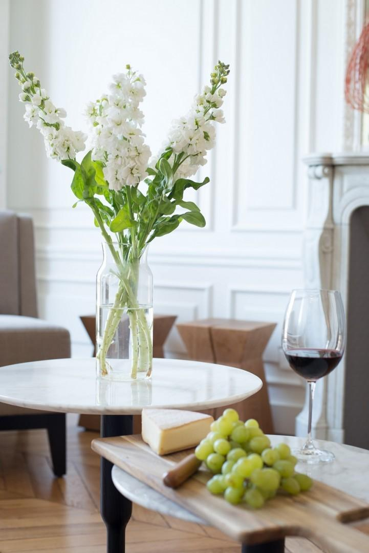 Bring home some freshly cut flowers and French cheeses.