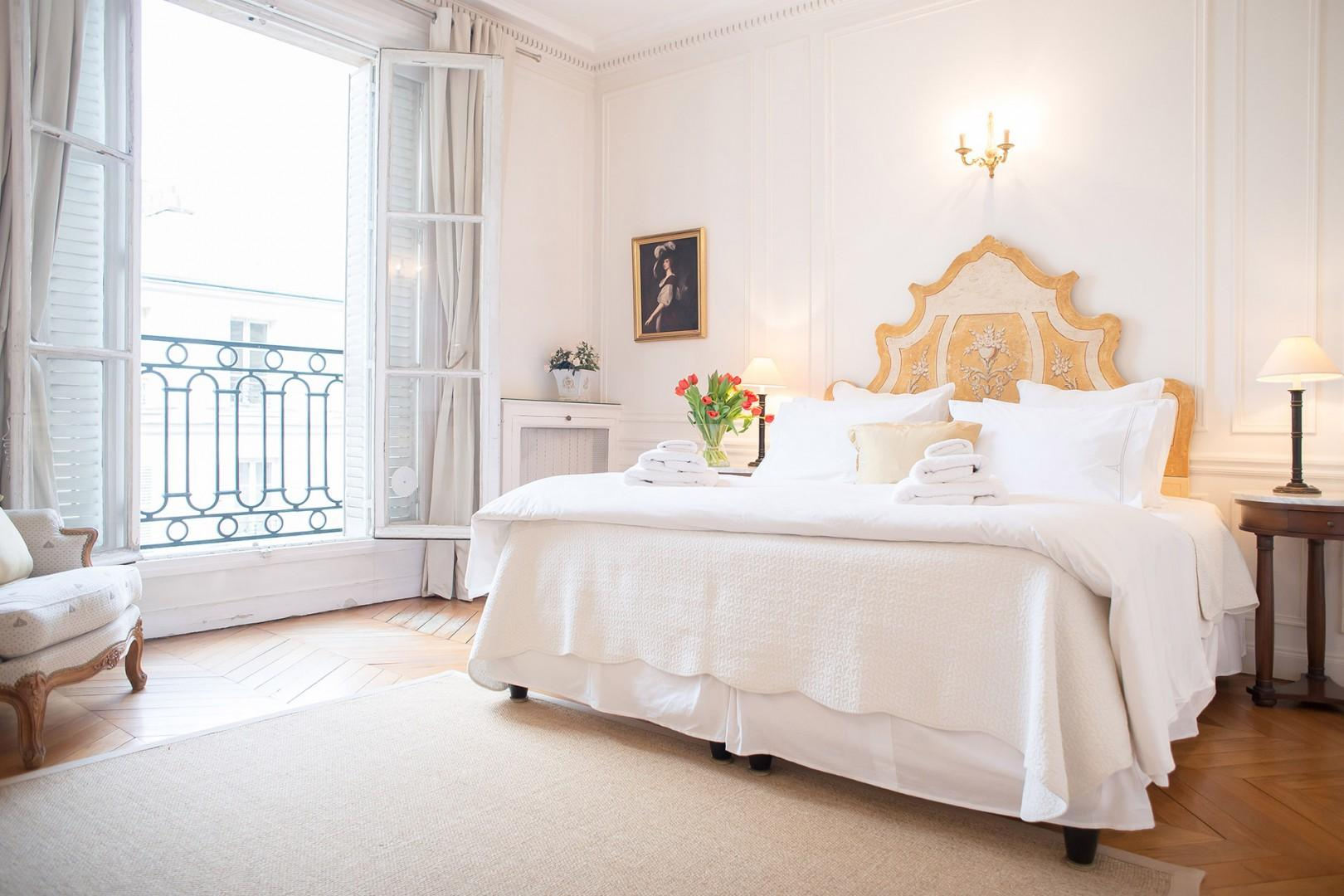 Enter the gracious bedroom 1 with comfortable bed that's fit for royalty.