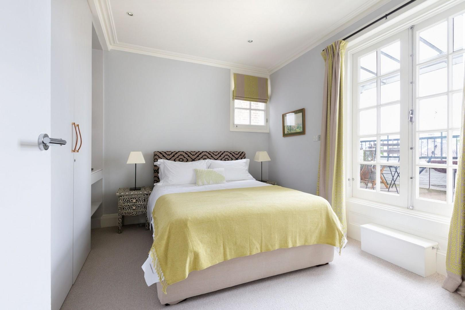 The second bedroom is airy and comfortable